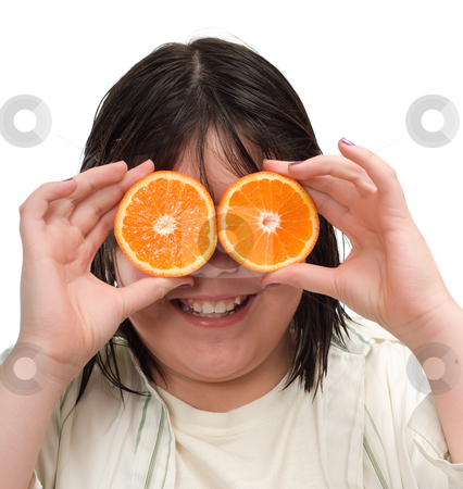 Orange Eyes stock photo, Closeup view of a young girl holding orange slices up for eyes, isolated against a white background by Richard Nelson
