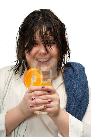 Citrus Drink stock photo, A young girl smiling and holding an orange drink with fresh fruit on the rim of the glass, isolated against a white background by Richard Nelson