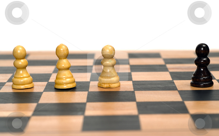 Segregation Concept stock photo, Concept image of a black chess pawn being segregated from the white chess pieces by Richard Nelson