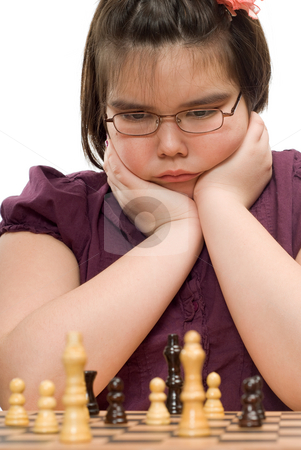 Thinking Child stock photo, A young girl thinking about her next move in a game of chess by Richard Nelson