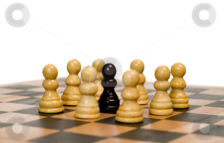 Racist Concept stock photo, Concept image of racism with some white chess pawns surrounding a black one by Richard Nelson