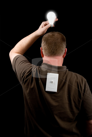 Bright Idea stock photo, A man holding a lighted lightbulb over his head. by Robert Byron
