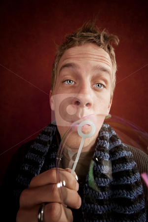 Young Man Blowing a Bubble stock photo, Handsome young blonde man blowing a bubble by Scott Griessel