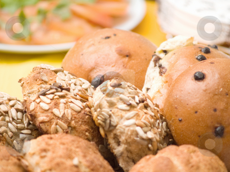 Delicious home made bread rolls stock photo, Delicious home made bread rolls on table by Phillip Dyhr Hobbs