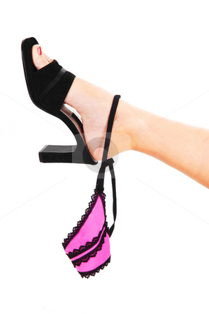 Womans foot with thong. stock photo, A young womans leg with black high heels holding up her nice pink thong with black elastic on. by Horst Petzold