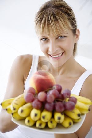 Woman offering fruit stock photo, Female holding a plate full of fresh fruit by Liv Friis-Larsen