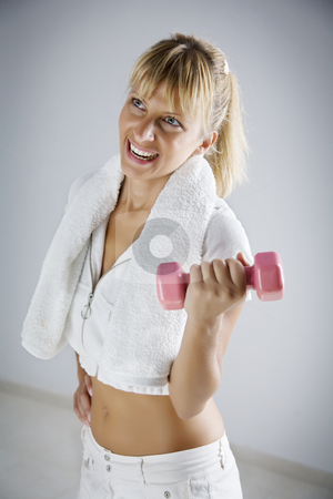 Exercising stock photo, Young smiling female with weight by Liv Friis-Larsen