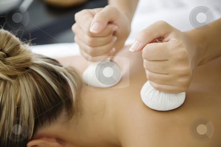 Tthai herbal massage stock photo, Closeup of woman receiving massage with herbal balls by Liv Friis-Larsen