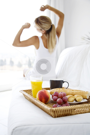 Morning stretching stock photo,  by Liv Friis-Larsen