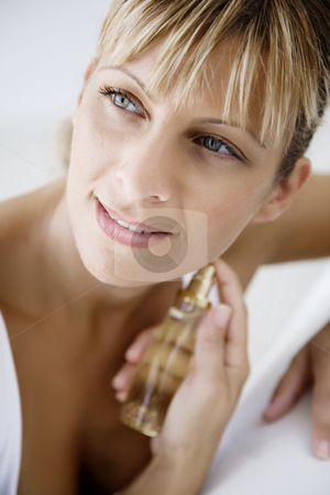 Applying perfume stock photo, Young female applying perfume (the bottle is a generic