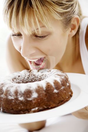 Temptation stock photo, Woman ready to bite into a cake by Liv Friis-Larsen
