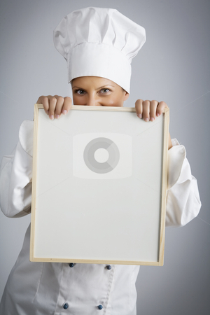 And todays menu is.. stock photo, Female  chef holding menu board by Liv Friis-Larsen