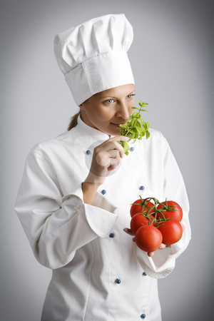 Fresh ingredients stock photo, Female chef  with fresh, natural ingredients by Liv Friis-Larsen