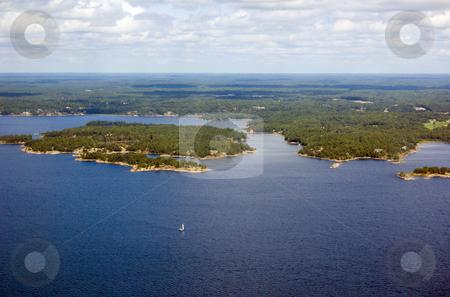 Sail stock photo, Bird's-eye view on lake and islands by Pavel Cheiko