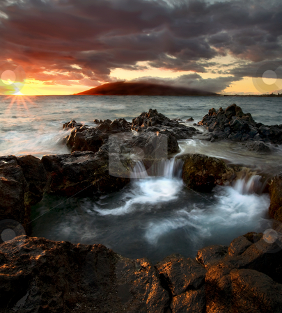 Sunset Cauldron stock photo, A natural cauldron filling as the sun sets over the rising tides off the South coast of Maui, Hawaii by Mike Dawson