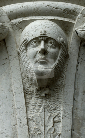 Stone head, Venice stock photo, A sculpted soldier's head, protected by a helmet and chain mail, at the top of a pillar on the Doge's Palace in Venice by Alistair Scott