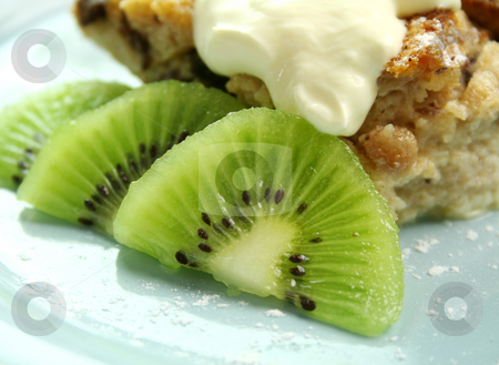 Kiwi Fruit stock photo, Kiwi fruit garnish with bread and butter pudding. by Brett Mulcahy