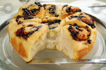 Chelsea Bun Cake stock photo, Delicious chelsea bun with dried fruit ready to serve. by Brett Mulcahy