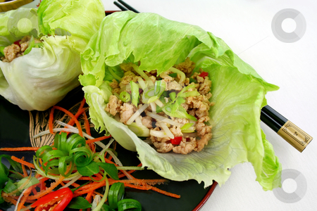 San Chow Bow stock photo, Delicious San Choy Bow with minced chicken and Chinese vegetables wrapped in fresh lettuce leaves. by Brett Mulcahy