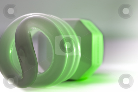 Compact Fluorescent Glow stock photo, A green glowing compact fluorescent bulb. by Kevin Woodrow