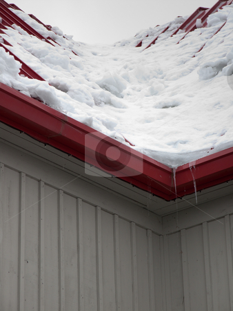 Snow load on red roof stock photo, Snow load on red roof by Kevin Woodrow