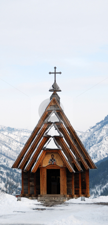 Wooden Church stock photo, Small wooden Orthodox church on top of a mountain surrounded with snow. by Denis Radovanovic