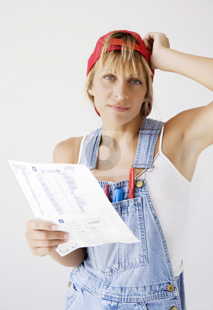 Confusing manual stock photo, Female DIY enthusiast confused about manual by Liv Friis-Larsen