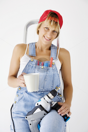 Coffee break stock photo, Female worker having a coffee break by Liv Friis-Larsen