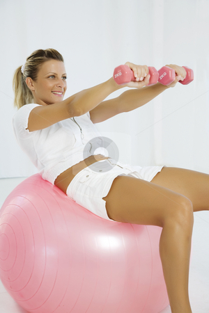 Situps stock photo, Young female doing situps on pilates ball by Liv Friis-Larsen