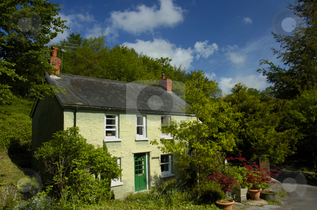Pen-y-Bont stock photo, A country cottage, in rural Wales, under a summer sky. by Alistair Scott