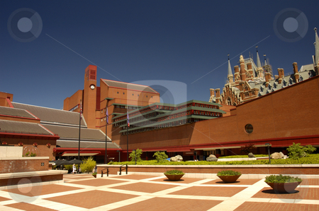 New and old stock photo, View of the courtyard of the british Library, London, with the gothic towers of St Pancras Station peeping over the top at the right. Space for text in the clear bluesky. by Alistair Scott