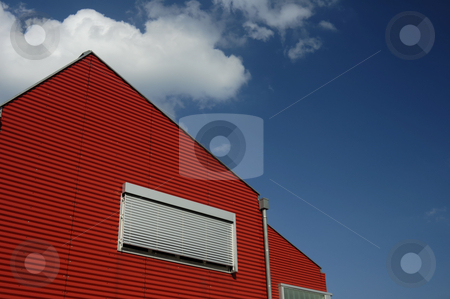 Red End stock photo, The red end of a building, against a blue summer sky. Space for text in the sky. by Alistair Scott
