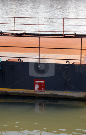 Water level stock photo, Old ruler pointing water level in river by Julija Sapic