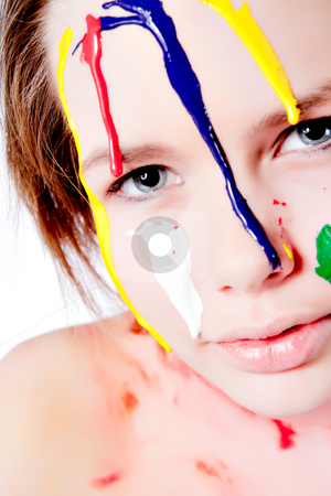 Wet colorfull paint dripping of my face stock photo, Studio portrait of a teenage girl painting herself by Frenk and Danielle Kaufmann