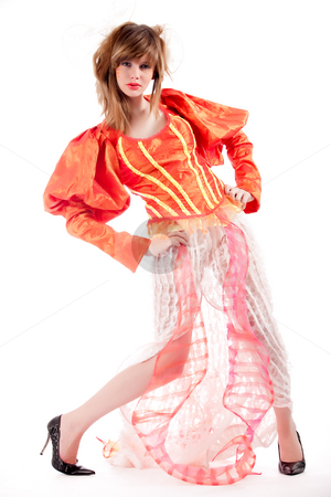 Cute teenage girl in an orange fancy dress posing stock photo, Studio portrait of a girl in a special stylised dress by Frenk and Danielle Kaufmann