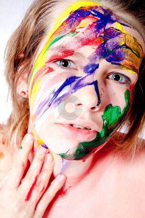 How do you like my self made wet paint make-up stock photo, Studio portrait of a teenage girl painting herself by Frenk and Danielle Kaufmann
