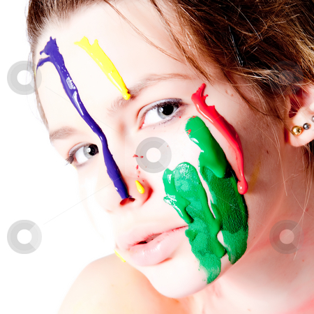 Teenage girl with four colors of paint on her face stock photo, Studio portrait of a teenage girl painting herself by Frenk and Danielle Kaufmann