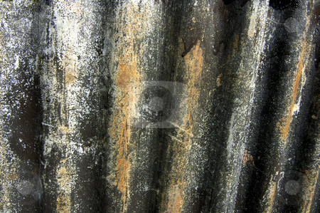 Grungy corrugated iron stock photo, Stock macro of a piece of grungy corrugated iron, once painted with black paint, but the paint now peeling off. Useful as abstract background. by Alistair Scott