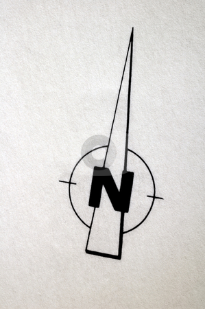 North stock photo, A compass rose, indicating North, on textured draughtsman's paper of a building plan. The paper is slightly grungy from use. Space for text in the image. by Alistair Scott