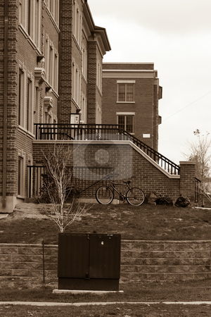 University residences stock photo, A university residence complex, in black and white, with a bike and garbage bags in the foreground. by Kevin Woodrow