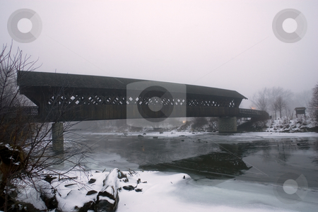 Covered Bridge in Winter stock photo, A covered walking bridge taken in winter, on an overcast early evening. by Kevin Woodrow