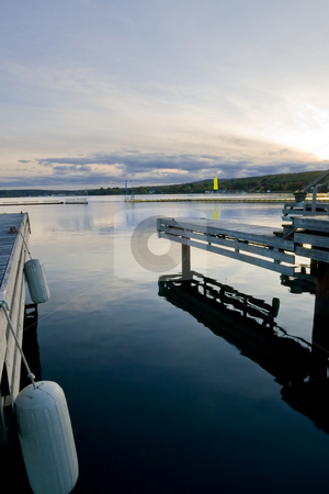 Empty Slip at dusk stock photo, An empty slip at the marina as the sun sets. by Kevin Woodrow
