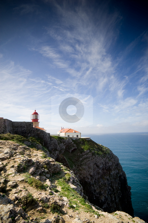 Lighthouse on the cliffs stock photo, The lighthouse at Cape Saint Vincent, near Sagres, Portugal, historically known as the 'end of the world' by Kevin Woodrow
