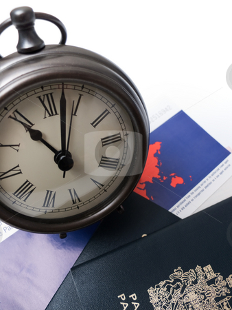 Time Travel stock photo, Travel documents under a clock, isolated on white. by Kevin Woodrow