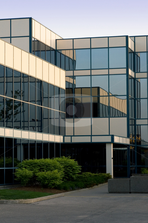 Office building in glass stock photo, A modern 3 storey glass office building. by Kevin Woodrow