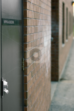 Shipping and Receiving - Vertical stock photo, Shipping and Receiving door with nameplate by Kevin Woodrow