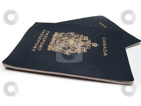 Canadian Passports stock photo, Two Canadian Passports, isolated on white. by Kevin Woodrow