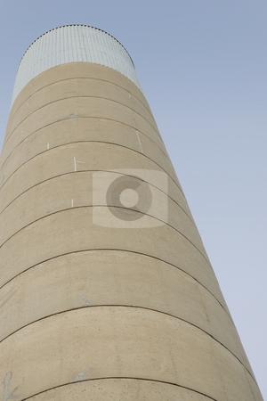 Smoke Stack stock photo, A concrete smoke stack rising into the sky. by Kevin Woodrow