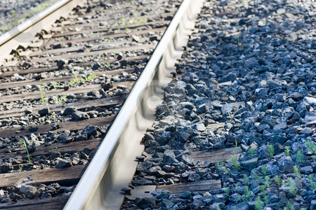 Train tracks closeup stock photo, An isolated portion of train tracks, focus on the rail. by Kevin Woodrow