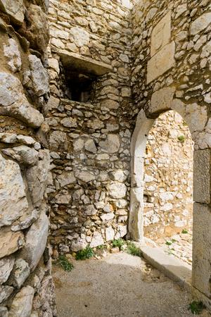 Go towards the light stock photo, An ancient entrance-way near Cape Saint Vincent, Sagres, Portugal. by Kevin Woodrow